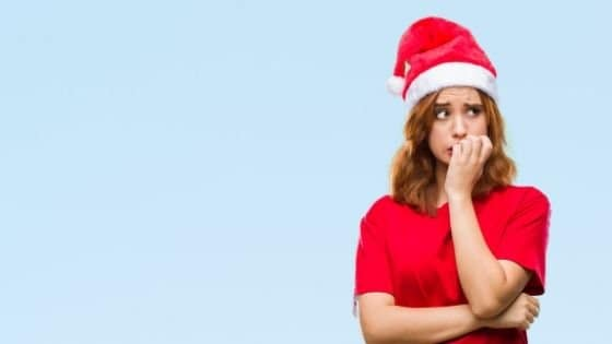 a woman with anxiety who is also wearing a santa holiday hat
