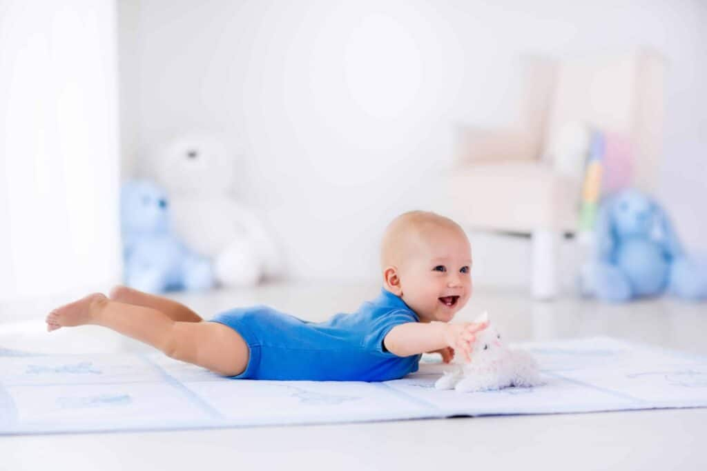 a happy baby doing tummy time