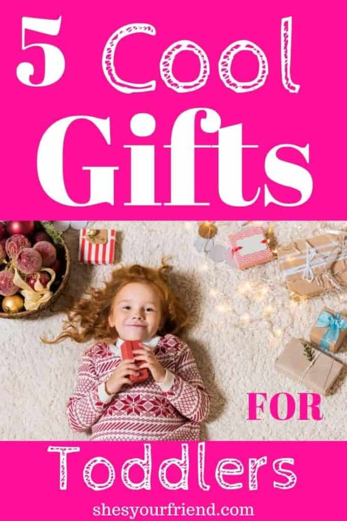 a toddler girl surrounded by cool gifts