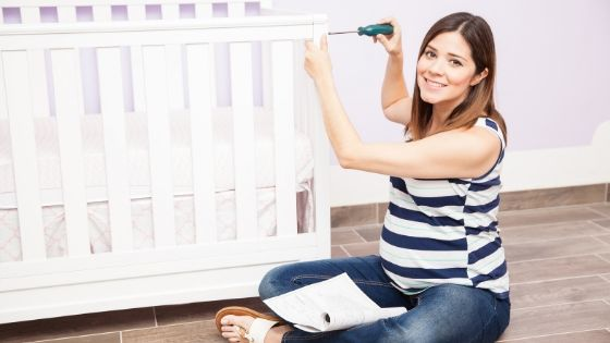 a woman who is nesting and finishing the nursery