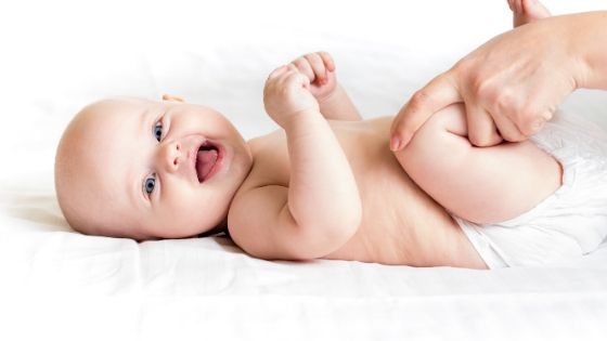 a baby doing bicycle exercise to help fart