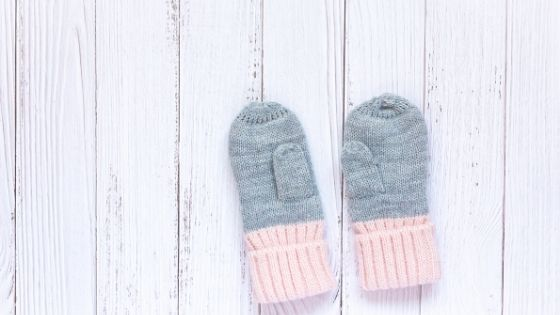 a pair of baby mittens
