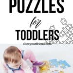 a toddler playing with a jigsaw puzzle