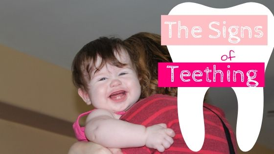 a baby showing the signs of teething