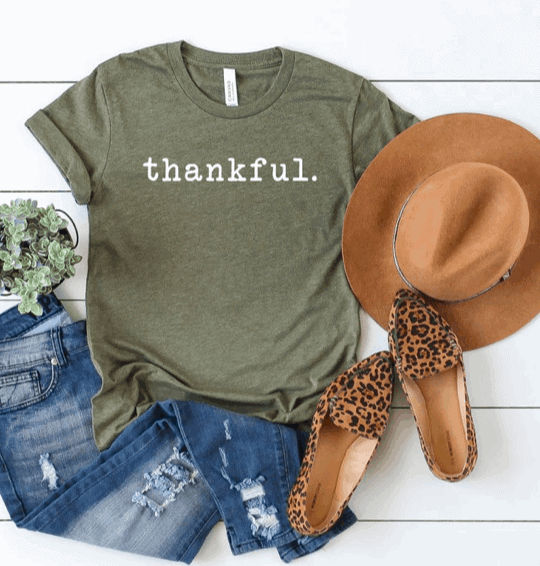 olive green shirt with thankful printed on it