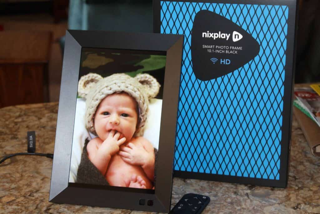 nixplay smart photo frame displaying a cute baby photo