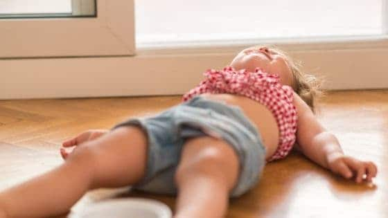 a toddler on the floor throwing a tantrum