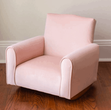 upholstered child's rocking chair
