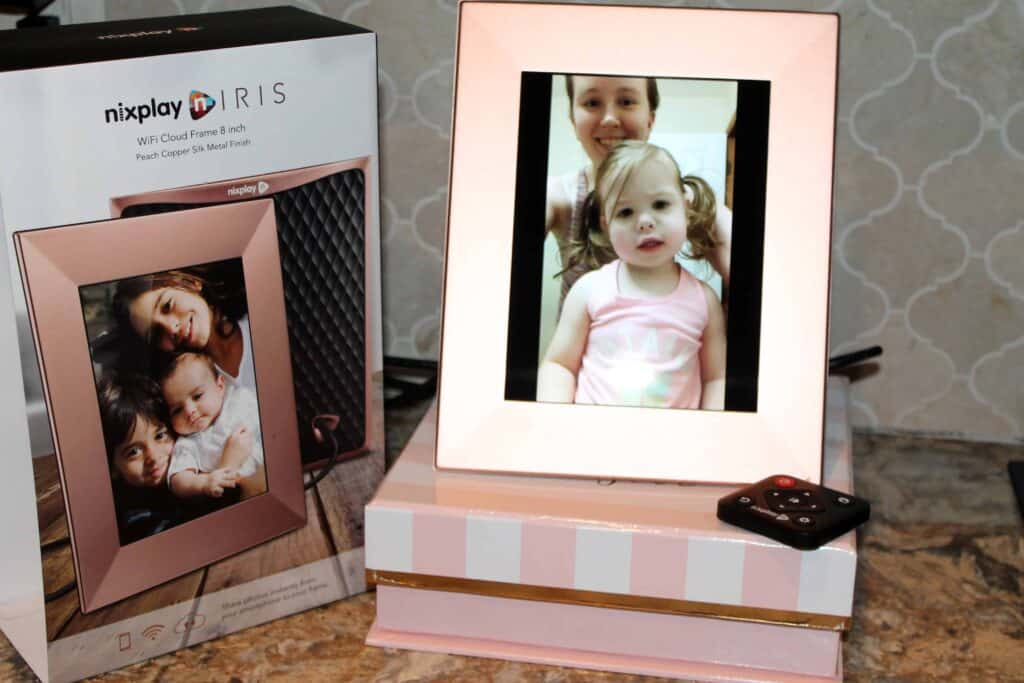 rose gold digital photo frame displaying a picture of a mom and daughter