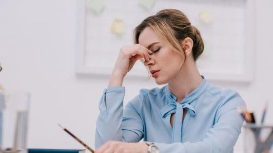 a woman in her office starting to feel sluggish in the afternoon