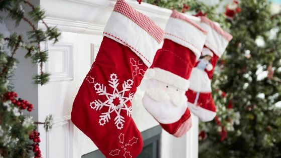Christmas stockings hung by the fireplace mantle