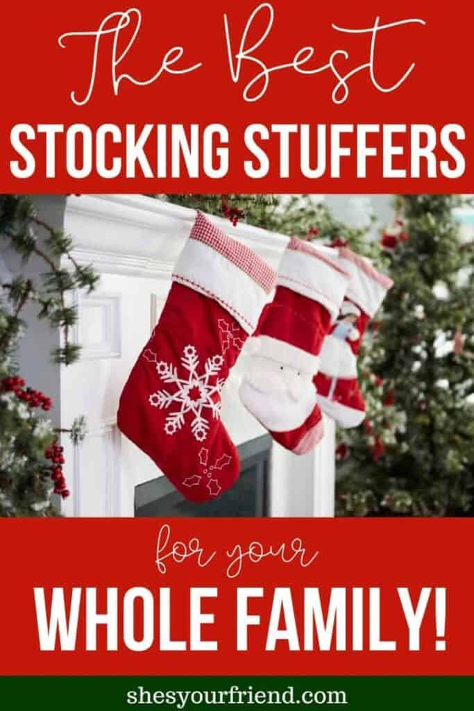 a pin image depicting christmas stockings hung by the fireplace mantle