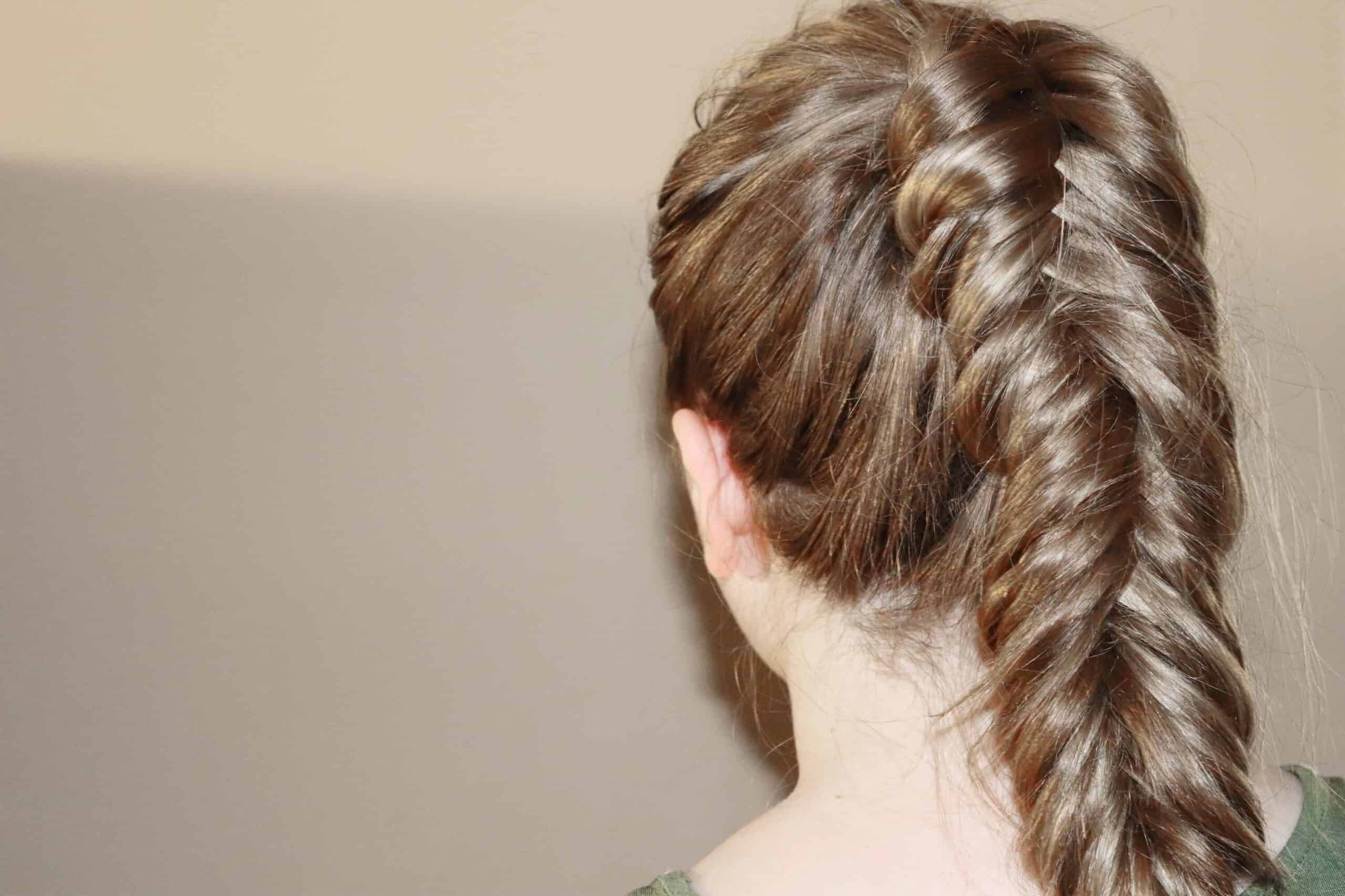 a woman with a fishtail braid on her ponytail