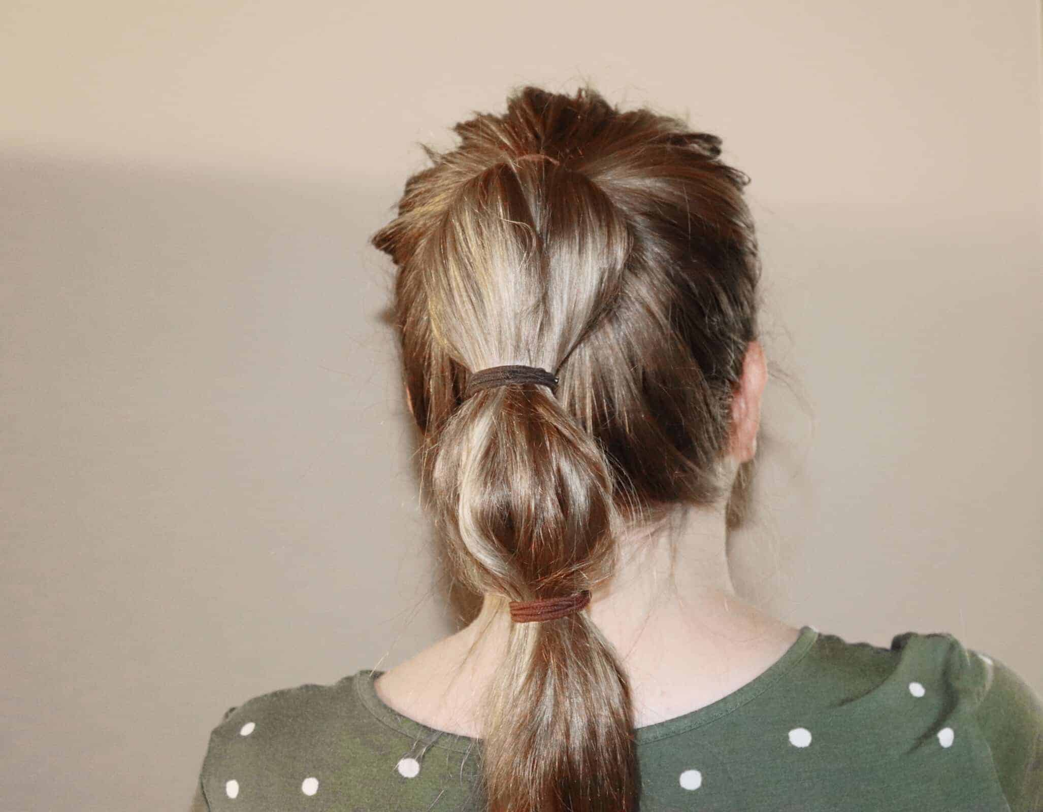 a woman with three ponytails