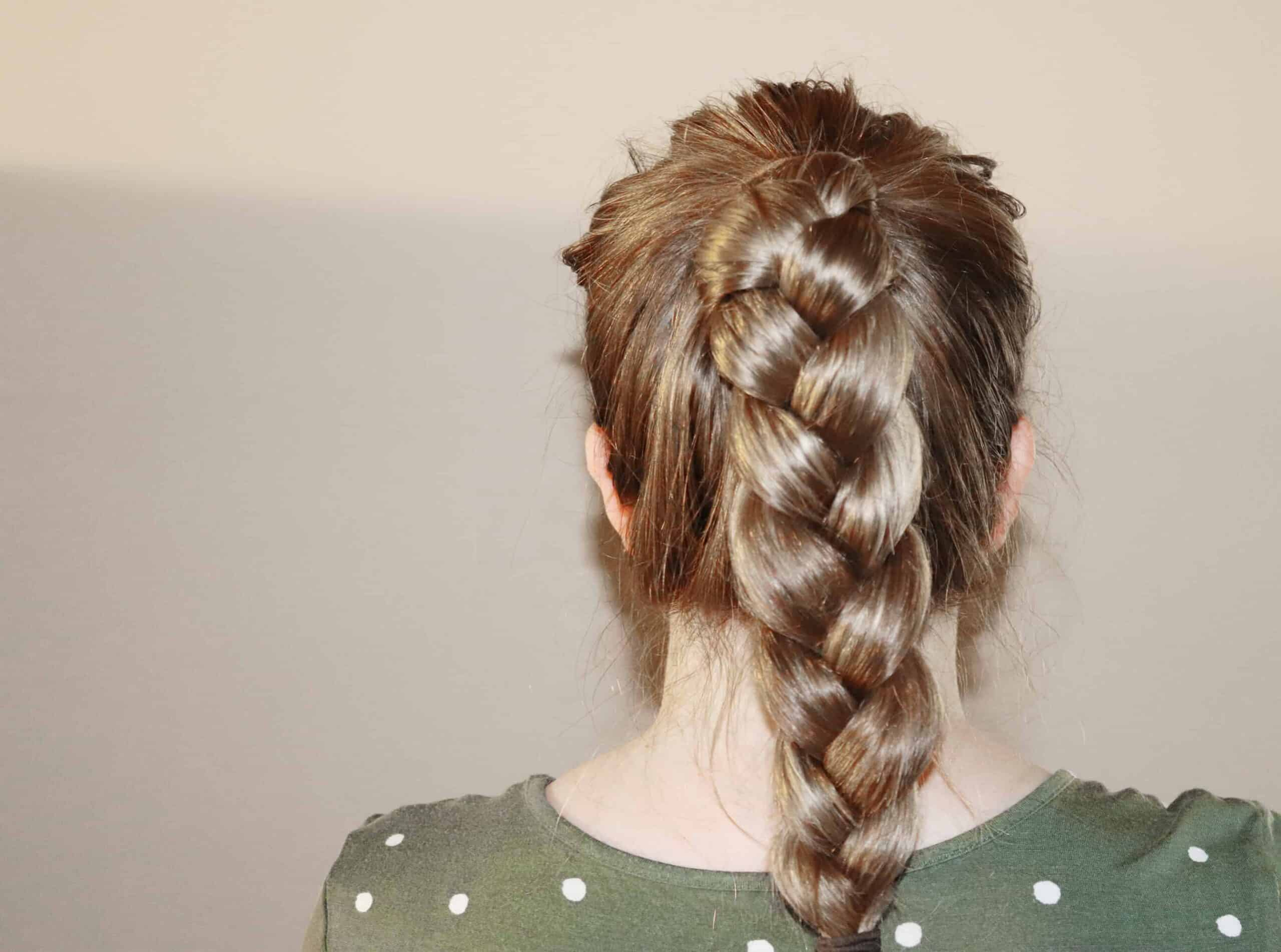 a woman with a braided ponytail