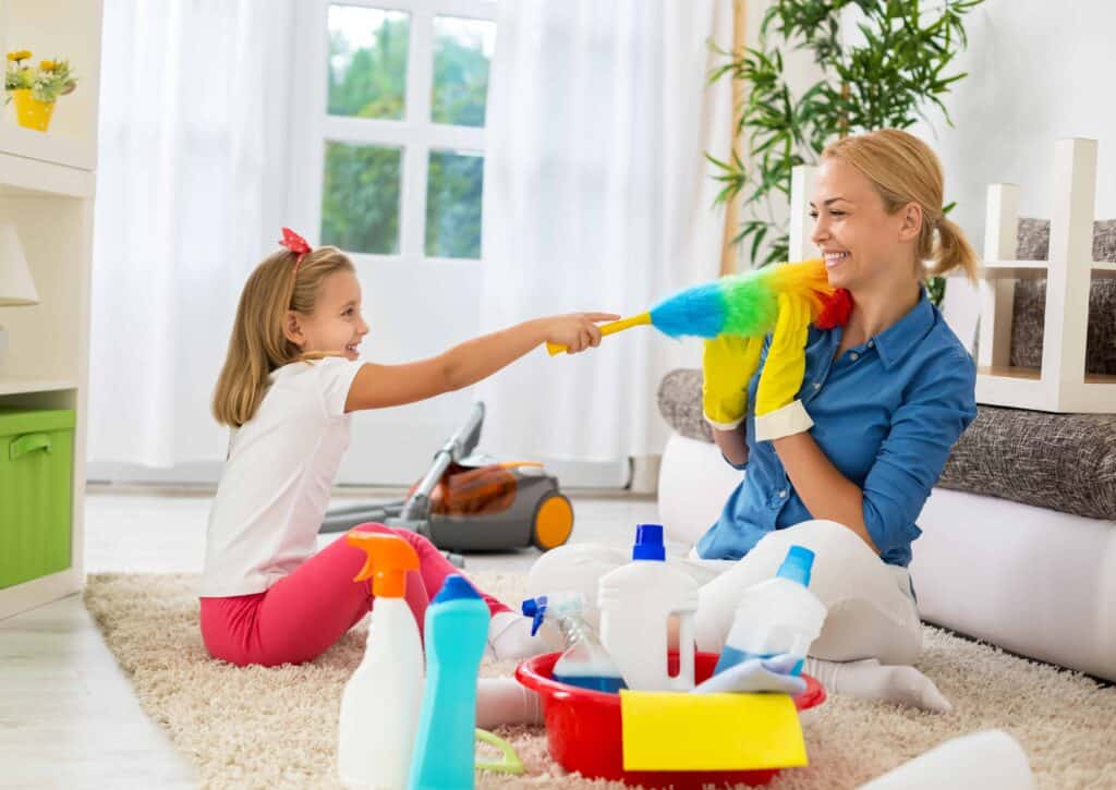a mother with her daughter teaching her how to do chores