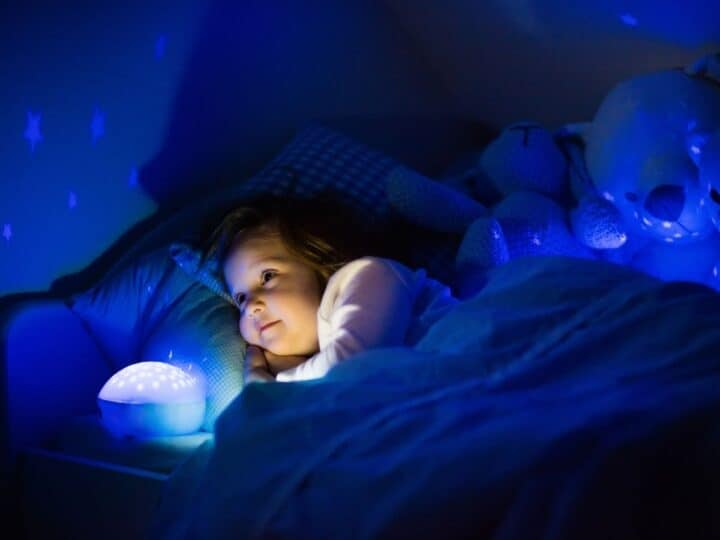 a little girl looking at her night light