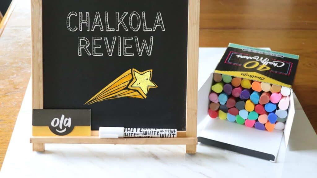 a chalk board standing next to a box of liquid chalk markers
