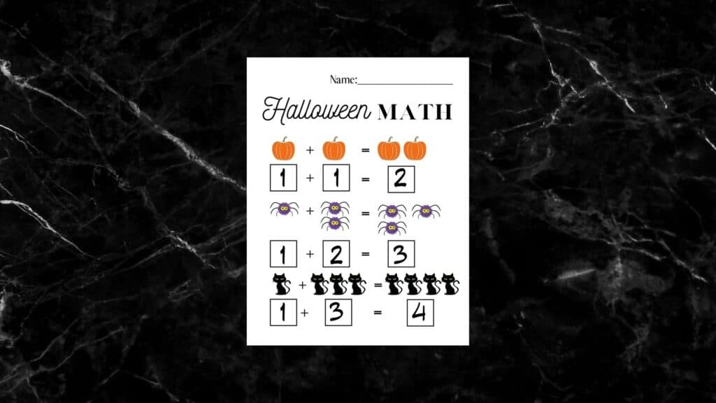 halloween math worksheet on black marble countertop