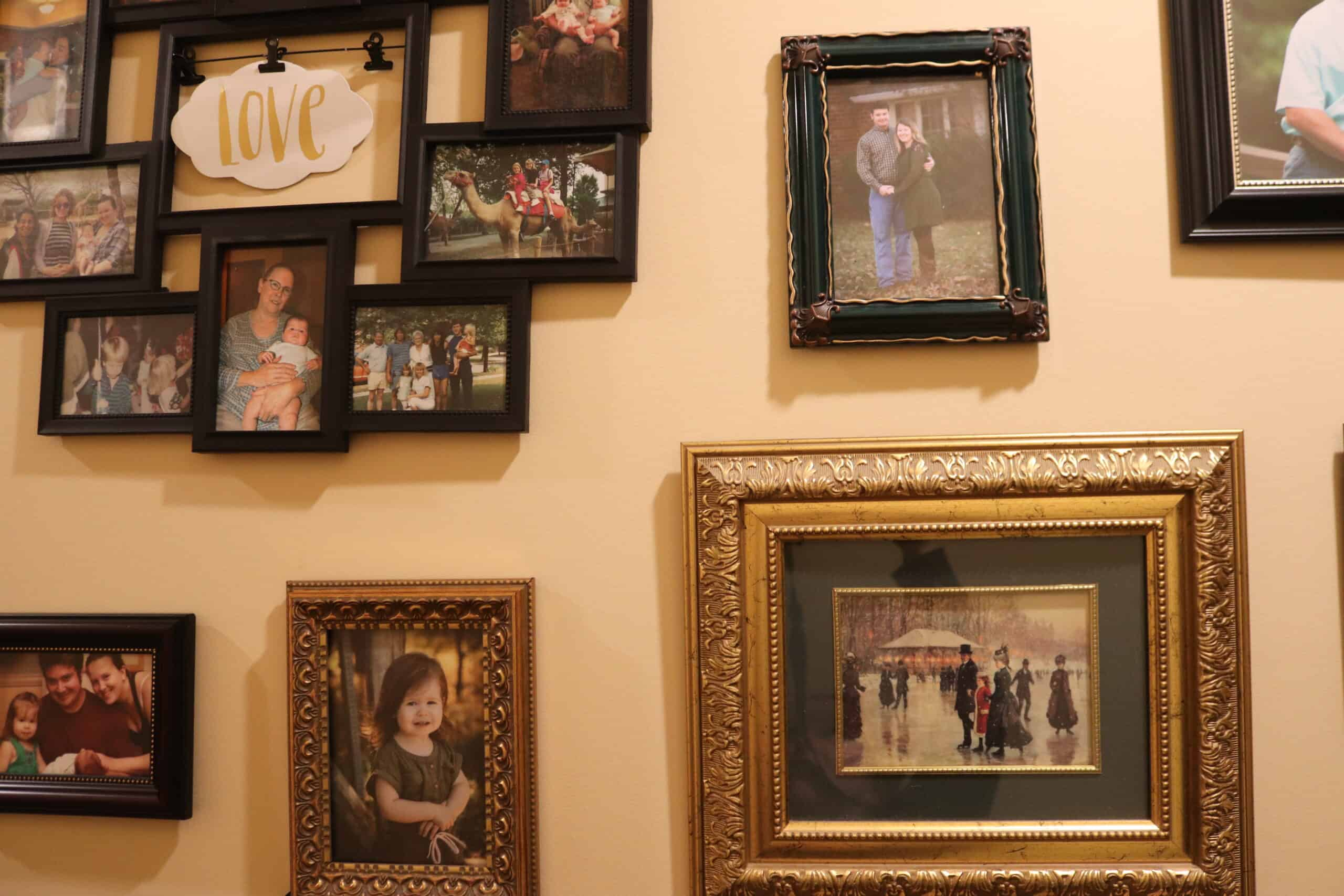 a buch of different picture frames hung on a wall