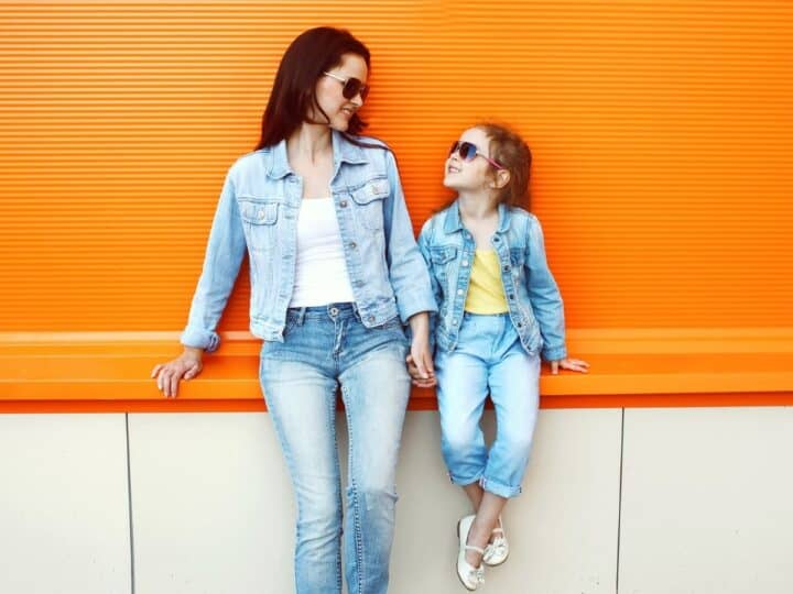 a stylish looking mom and daughter posing for a camera