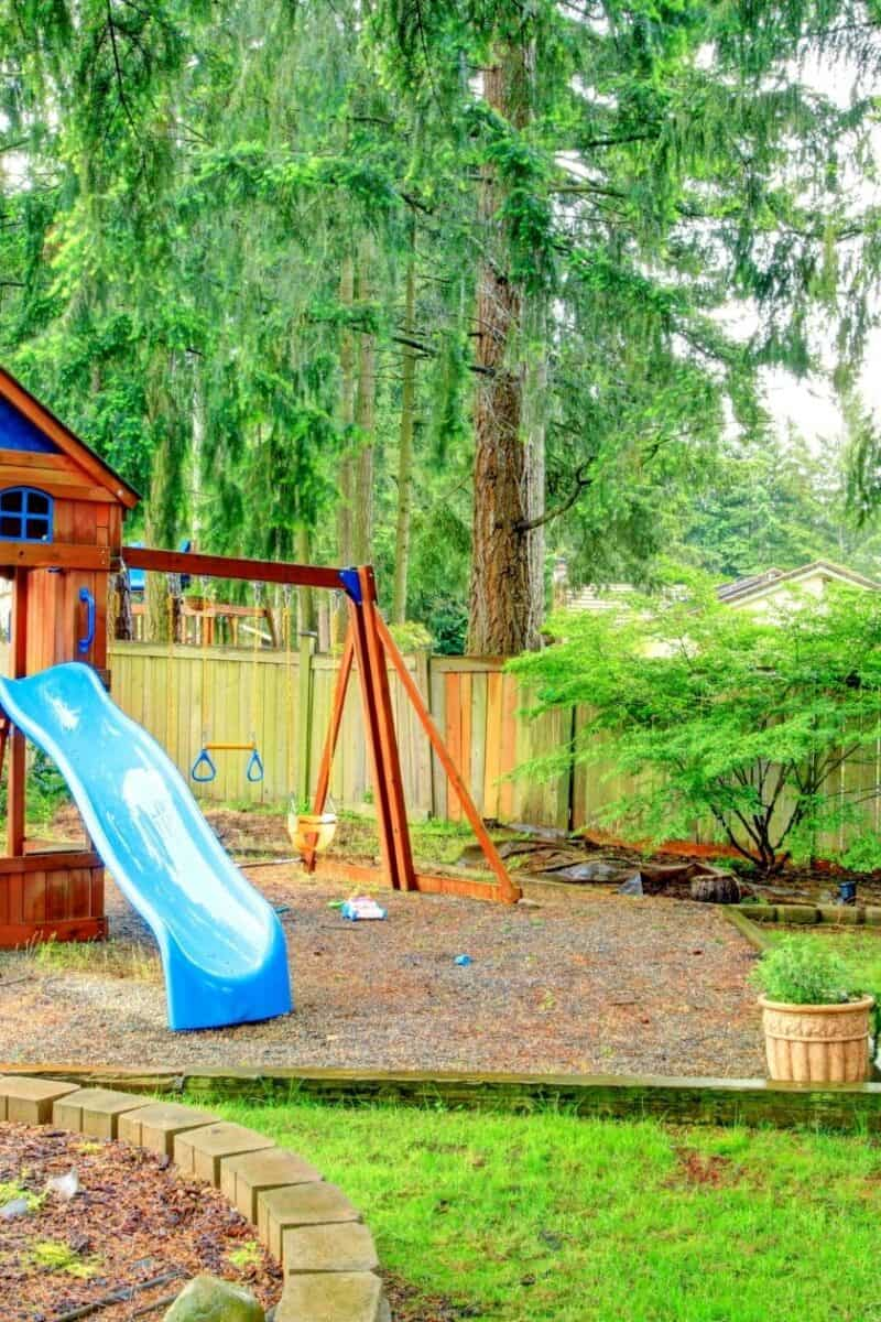 a fun playground set in a backyard of a home