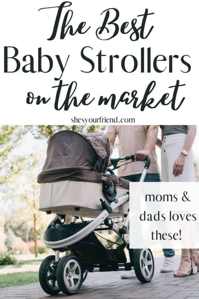 a mom and dad pushing a baby stroller on a sidewalk