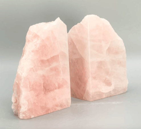 two book ends made out of natural rose quartz