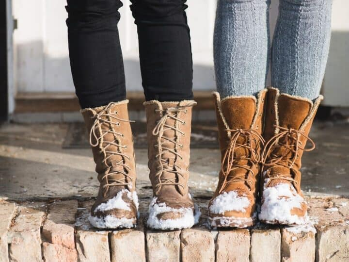 two women wearing styling snow boots