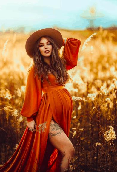 a pregnant woman wearing a silk maternity dress from Silk Fairies