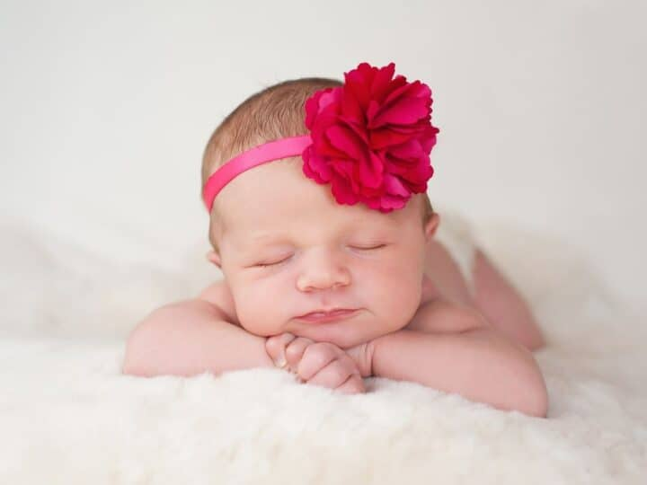 a baby girl with a flower headband