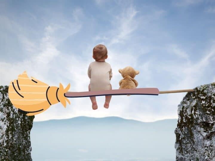 a baby with a teddy bear riding on a broom